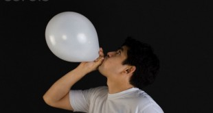 Man blowing air into a balloon